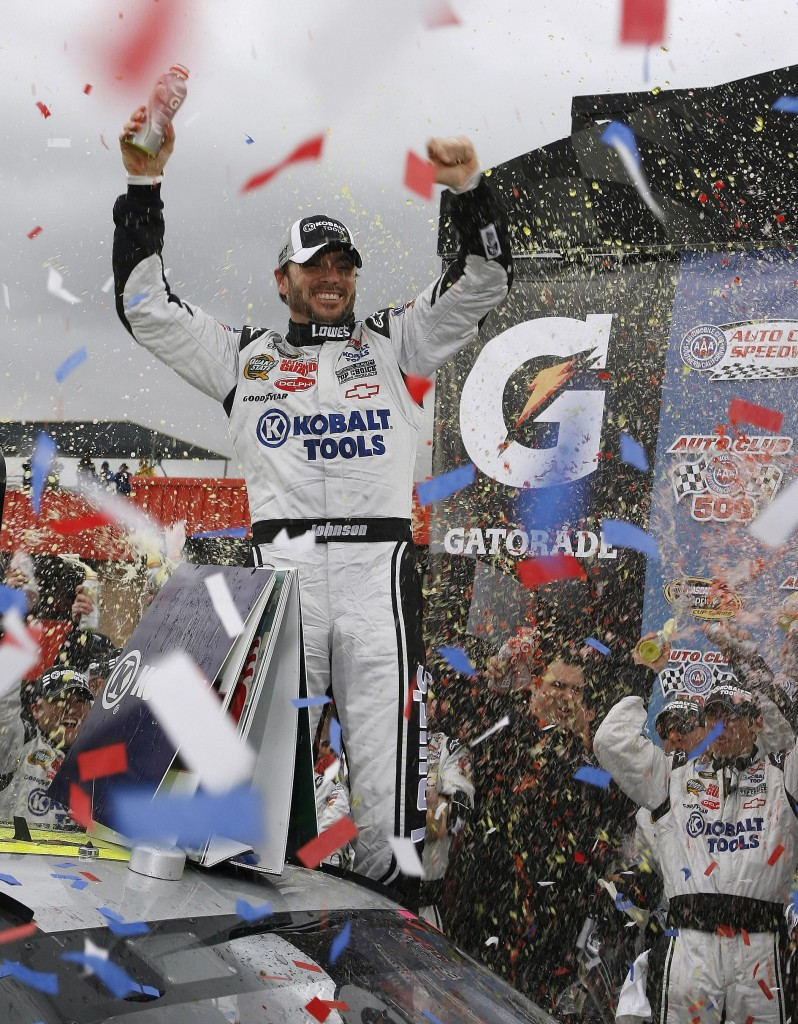 Jimmie Johnson strikes a familiar pose Sunday after winning the Auto Club 500, the 48th career victory for the four-time defending Sprnt Cup champion.
