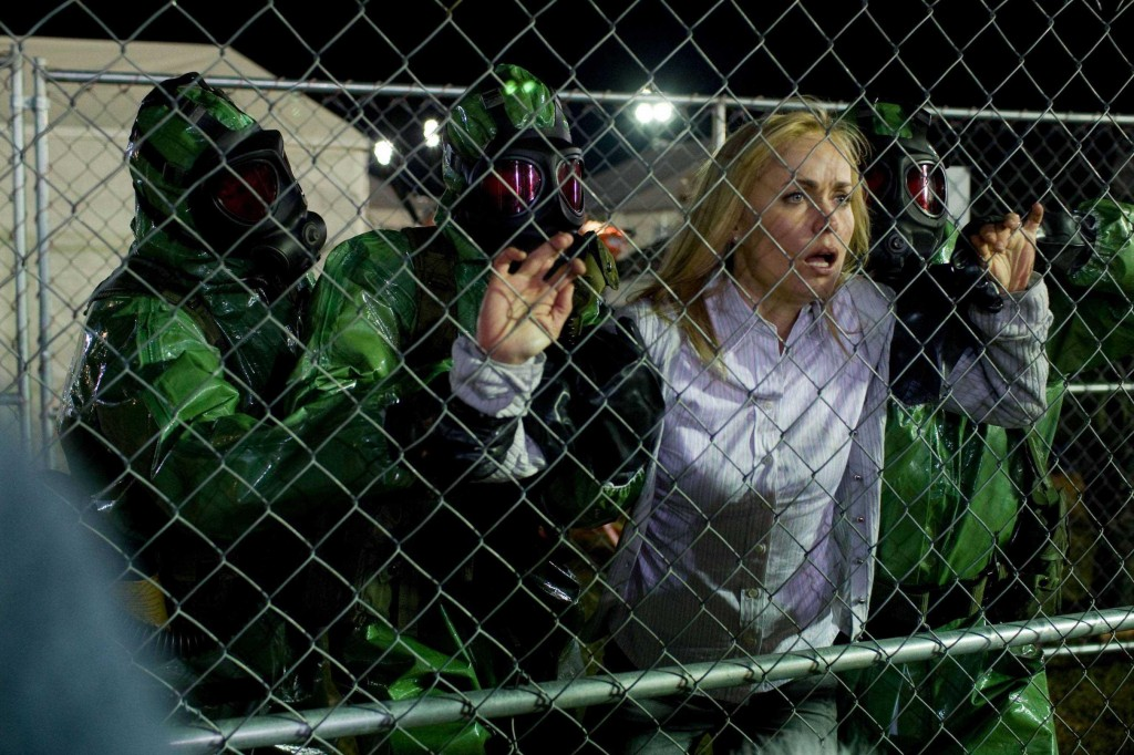 "Radha Mitchell stars in ""The Crazies,"" in which a small town is suddenly plagued by insanity and death after its water supply is mysteriously contaminated."