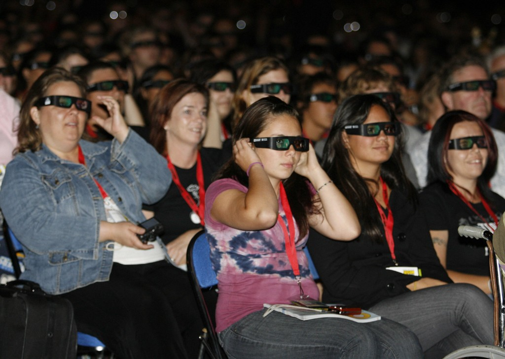 """Fans wear 3-D glasses for the movie """"Alice in Wonderland"""" at the Comic-Con International 2009 convention held in July in San Diego. Movies in 3-D are becoming such big moneymakers that studios are cramming them on short runs into theaters."""