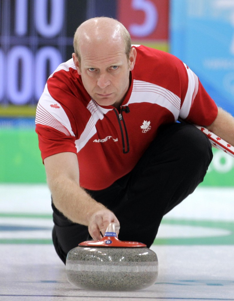 Canada skip Kevin Martin sends the stone along the ice during a match against the United States. Canada remained unbeaten with a 7-2 victory Monday.