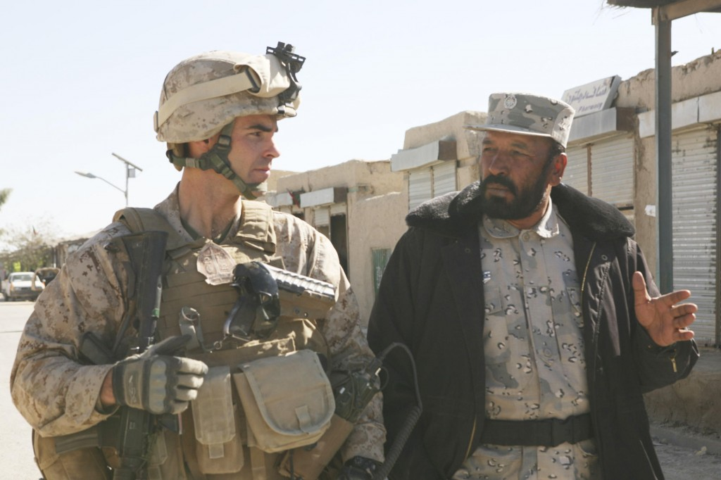 Marine Lt. Col. John E. McDonough walks with Lt. Col. Gul Aqa Amiry, the border police commander, in Garmsir, Afghanistan, after a security consultation at the district governor's compound in November. McDonough, a Portland High graduate, served in Iraq in 2003 during Operation Iraqi Freedom and later was awarded a Bronze Star.
