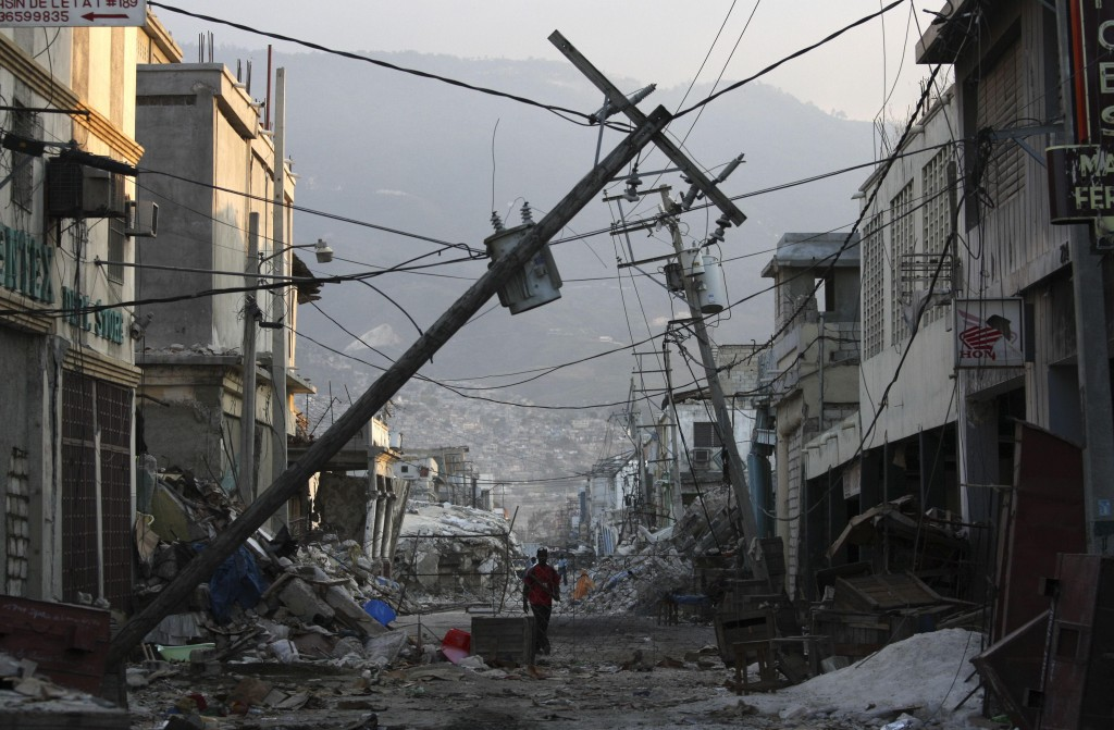 Power poles and cables still lie snapped on streets all over Port-au-Prince more than a month after the Jan. 12 earthquake. The city immediately needs $40 million to get its grid back to pre-quake status and pay its workers, hundreds of whom are living in tents.