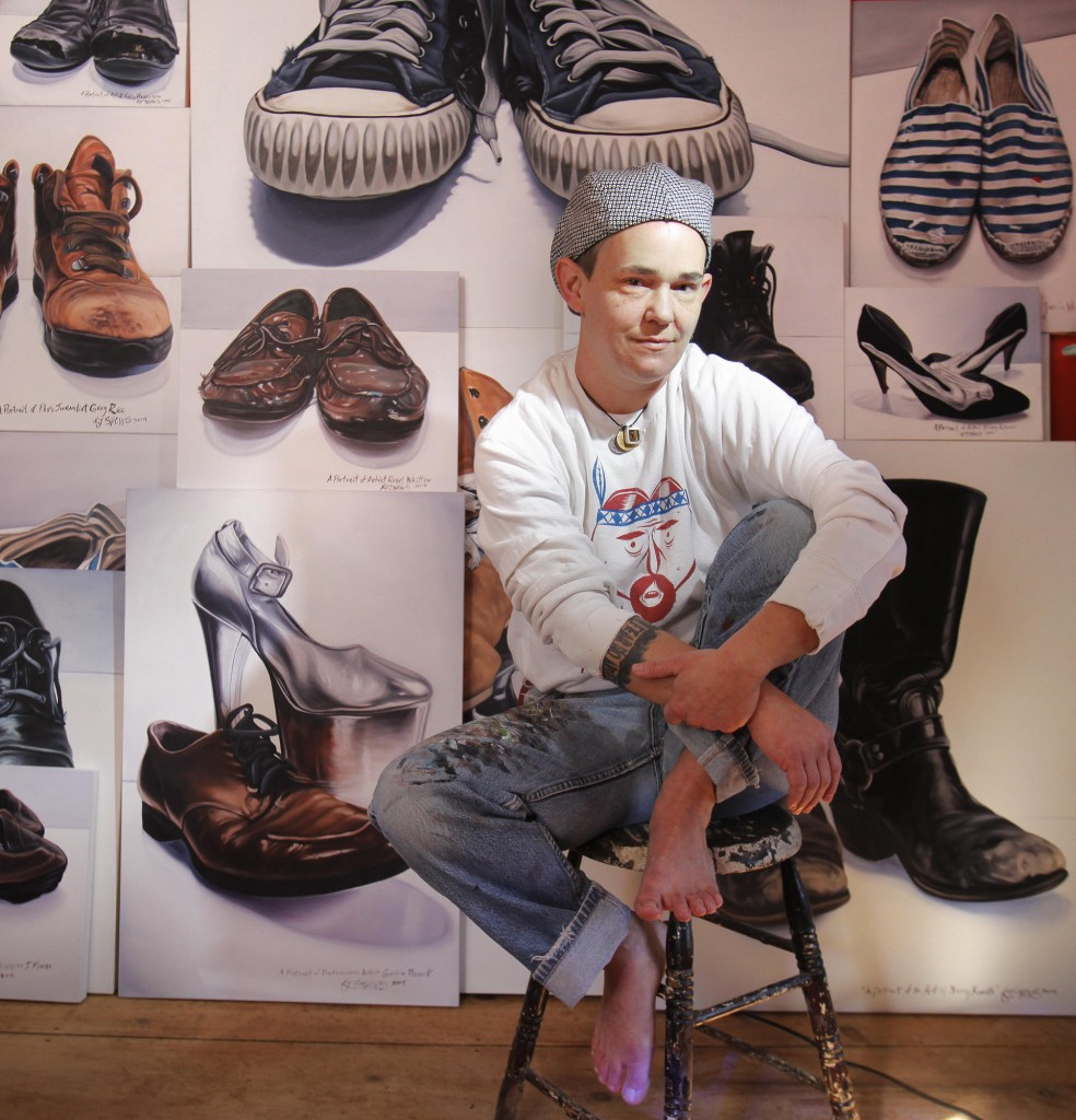 Kelly Jo Shows at home in Kennebunk with some of her shoe portraits.