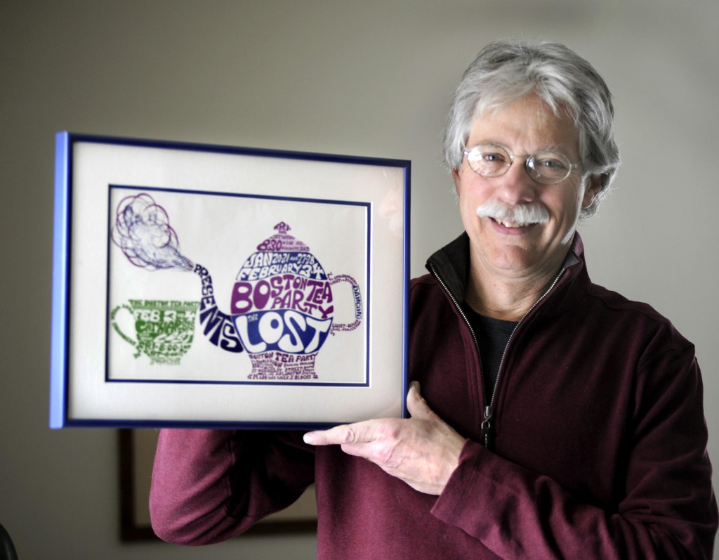 David Kinsman poses with a piece from his collection of vintage rock posters, this one from the '60s-era nightclub the Boston Tea Party.