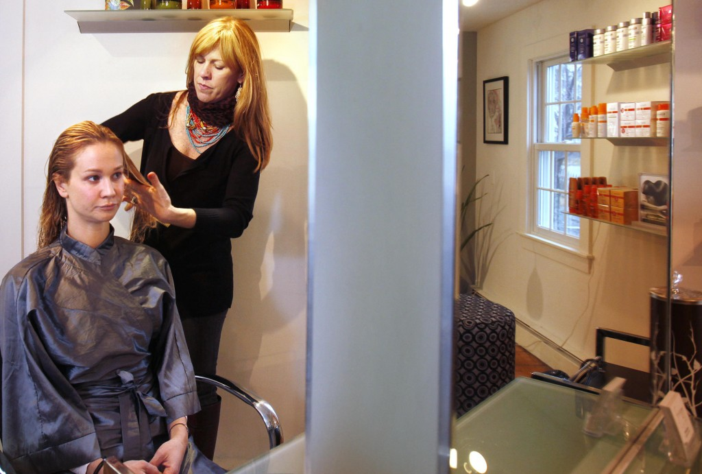Sheryl Miller-Barrett has worked in top hair salons in New York and Las Vegas. She opened Fringe Hair Art in Kennebunkport last year. Here she works with client Shana Aldrich in her salon.