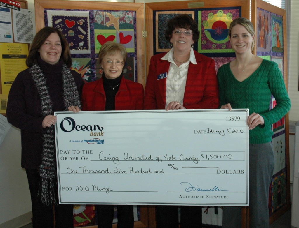 Ocean Bank donated $1,500 to Caring Unlimited of York County in support of its 10th Annual Atlantic Plunge on New Year's Day. Pictured from left to right are Caring Unlimited Director Cindi Peoples, Ocean Bank executives Sandy Bisson and Mary Matheson, and Caring Unlimited's Emily Flowers.