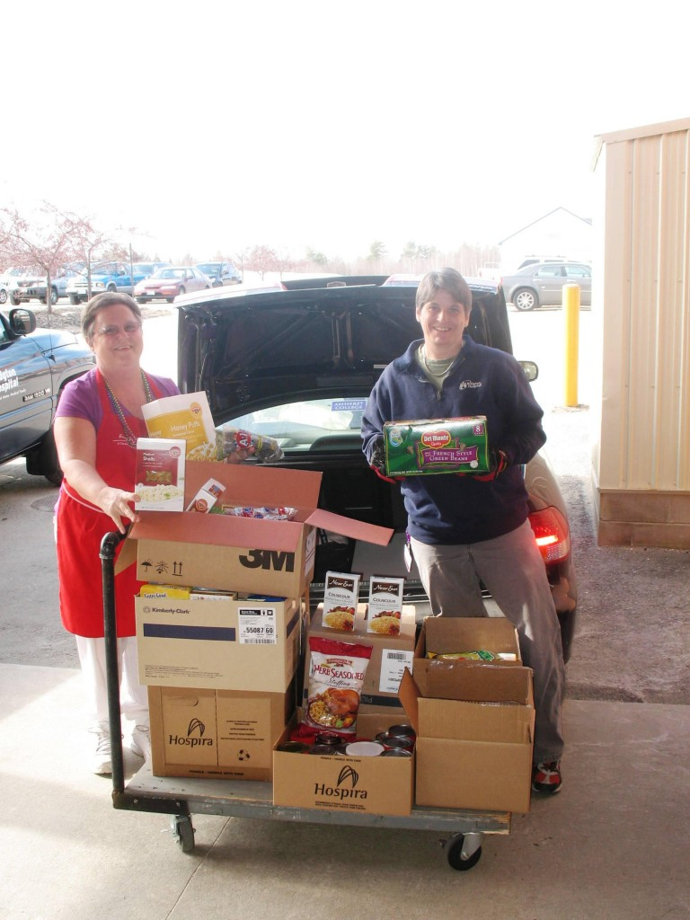 Carol Miller, left, and Lori Stevens helped coordinate a food drive sponsored by staffers at Bridgton Hospital, collecting 500 pounds of goods for a church pantry.
