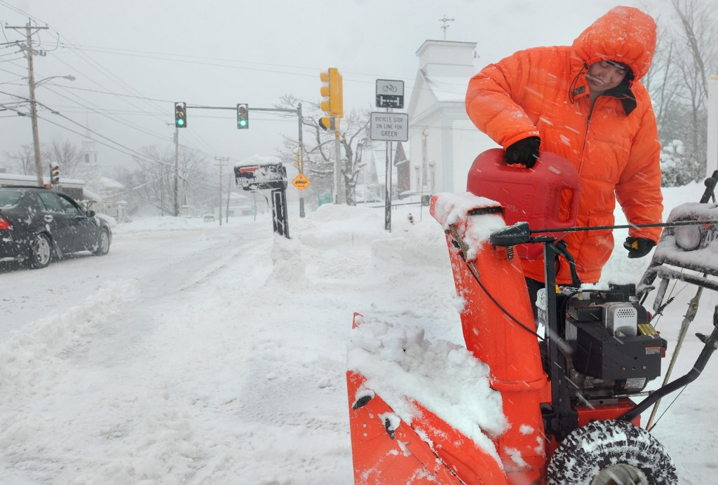 Walter Taylor refills his snowblower in Westminster, Mass., on Wednesday. As another storm approaches, up to 2 feet of snow are possible in parts of New York and Vermont.
