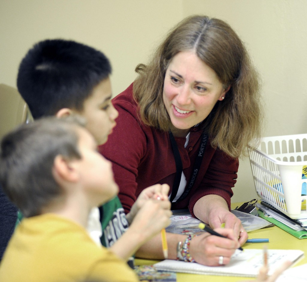 Teacher Lara Pratt works with second-graders Alex Sim and Zack LaCour at Longfellow Elementary School in Portland.