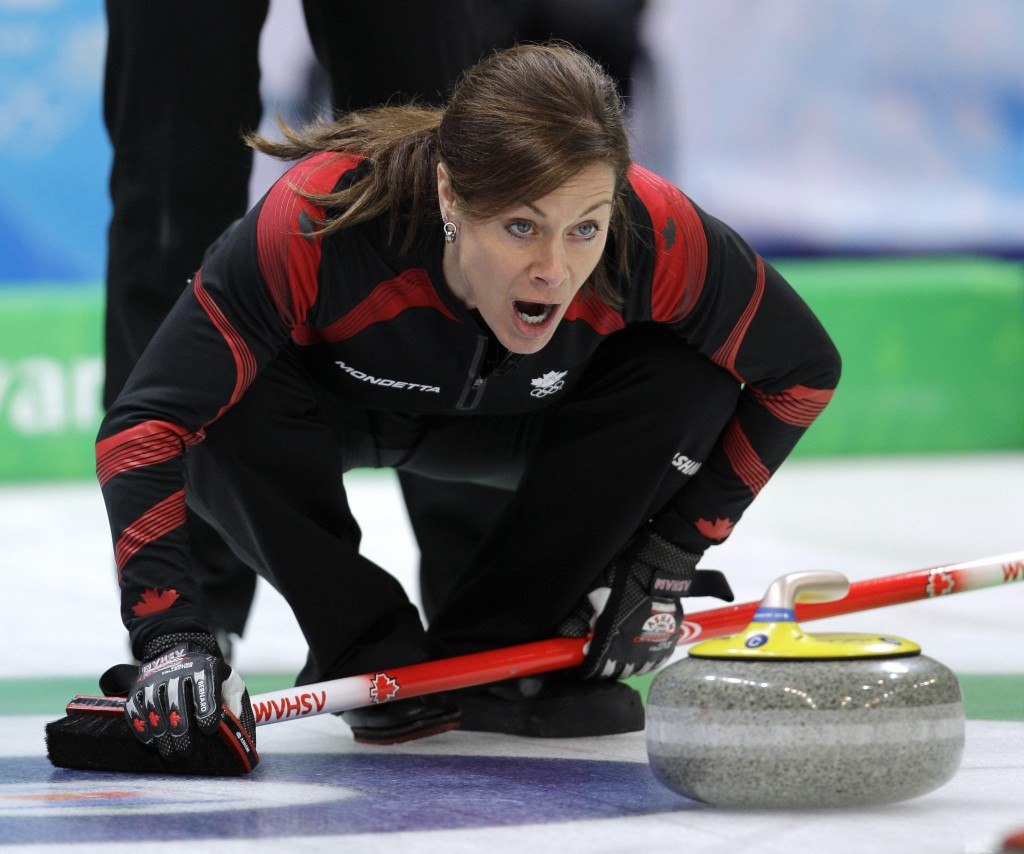 Canada's skip Cheryl Bernard shouts to her sweepers in a semi-final womens curling match against Switzerland at the Vancouver 2010 Olympics in Vancouver, British Columbia, Thursday, Feb. 25, 2010. (AP Photo/Robert F. Bukaty)