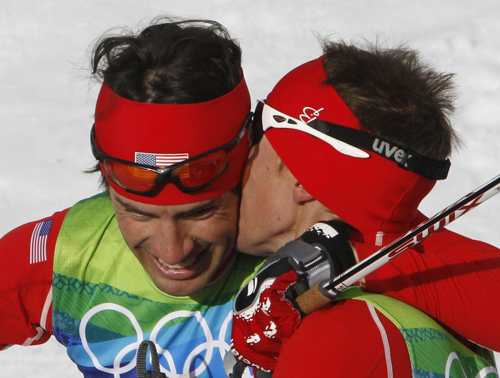 United States' gold medal winner Bill Demong, right, kisses United States' silver medalist Johnny Spillane during the Men's Nordic Combined Individual event from the large hill at the Vancouver 2010 Olympics in Whistler, British Columbia, Canada, Thursday, Feb. 25, 2010. (AP Photo/Matthias Schrader)