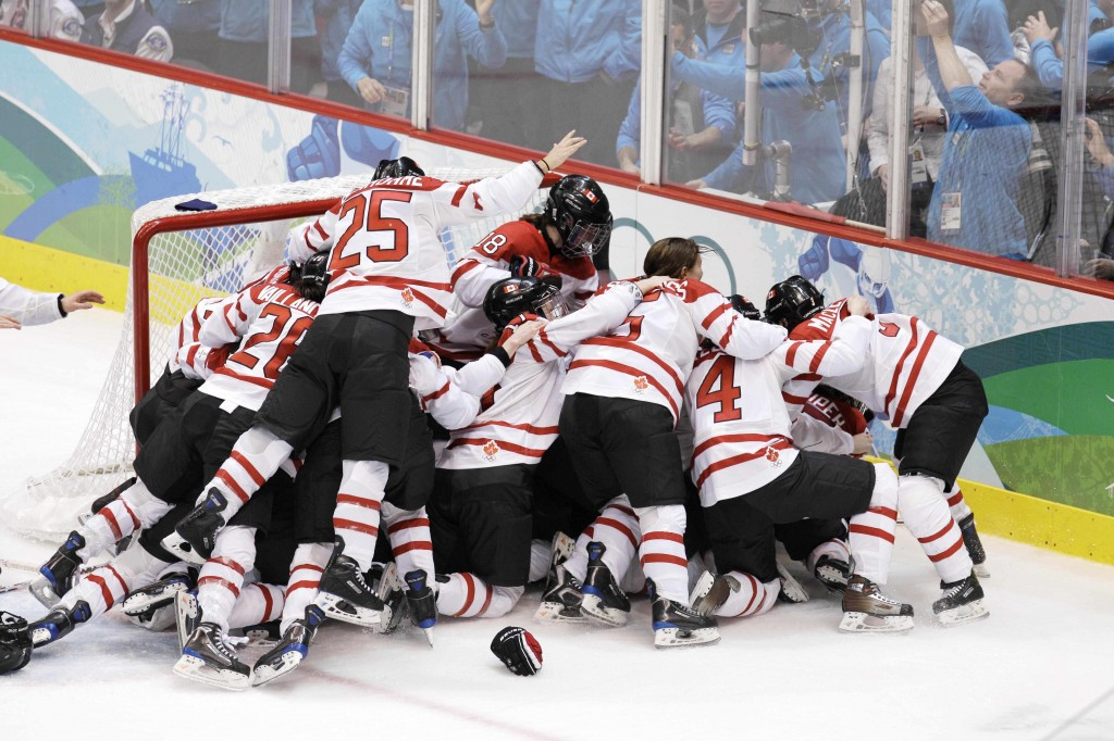Canadian players celebrate after they beat the USA 2-0 to win the women's gold medal ice hockey game at the Vancouver 2010 Olympics in Vancouver, British Columbia, Thursday, Feb. 25, 2010. (AP Photo/Chris O'Meara)