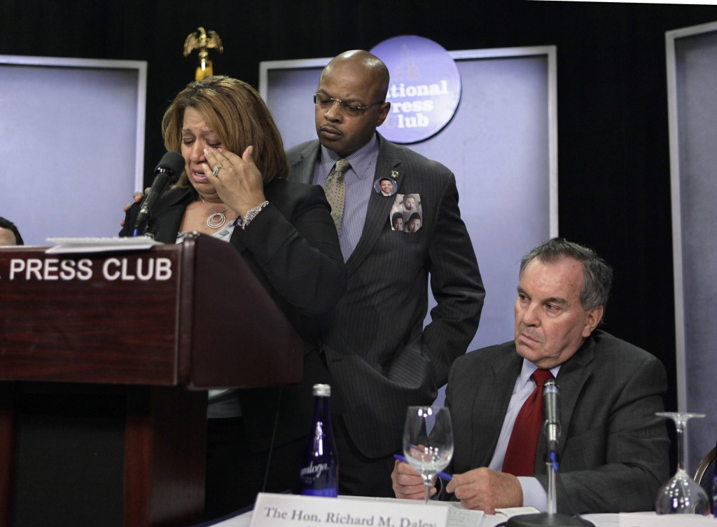 Chicago firefighter Annette Nance-Holt, left, weeps as she recalls the death of her son, Blair, who was a victim of gun violence, during a news conference this month in Chicago. Behind her is her husband, Chicago Police Officer Ronald Holt. At right is Chicago Mayor Richard M. Daley. The Supreme Court this week will consider a gun rights case: McDonald v. Chicago.