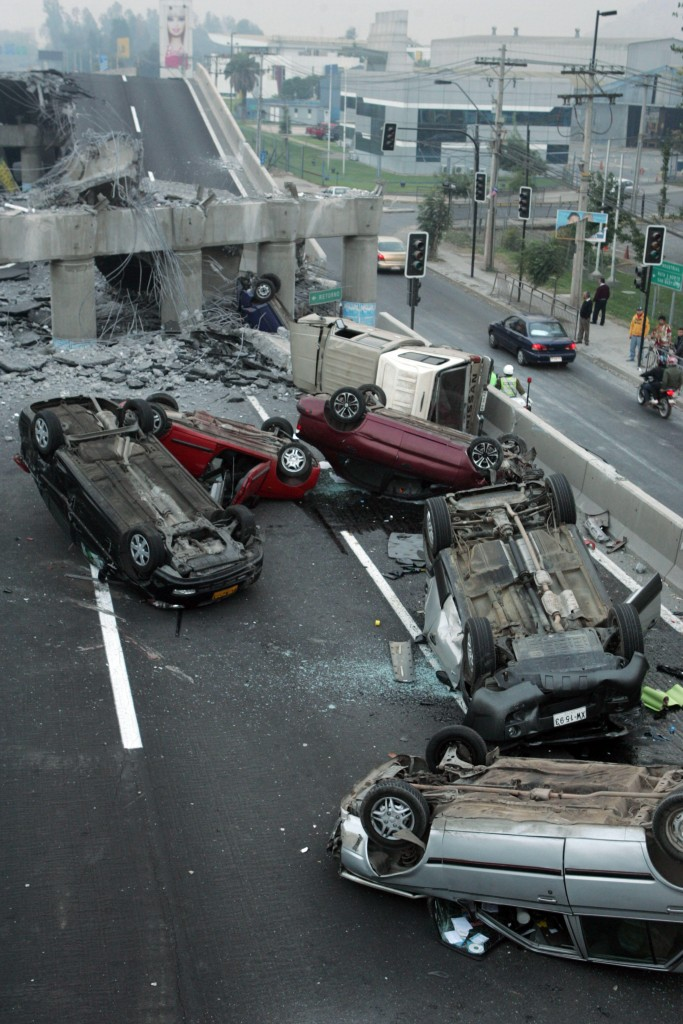 Vehicles litter a collapsed highway near Santiago after a powerful quake struck central Chile early Saturday.