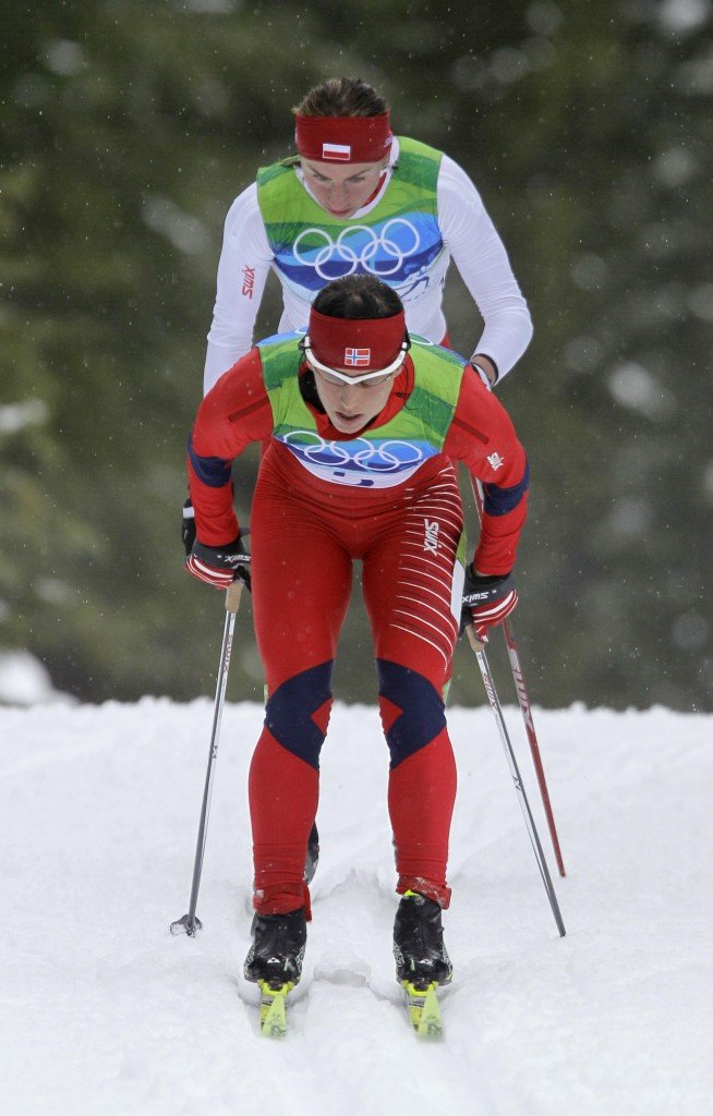 Marit Bjoergen of Norway leads Poland's Justyna Kowalczyk at the start of the women's 30K mass start classical cross country race.