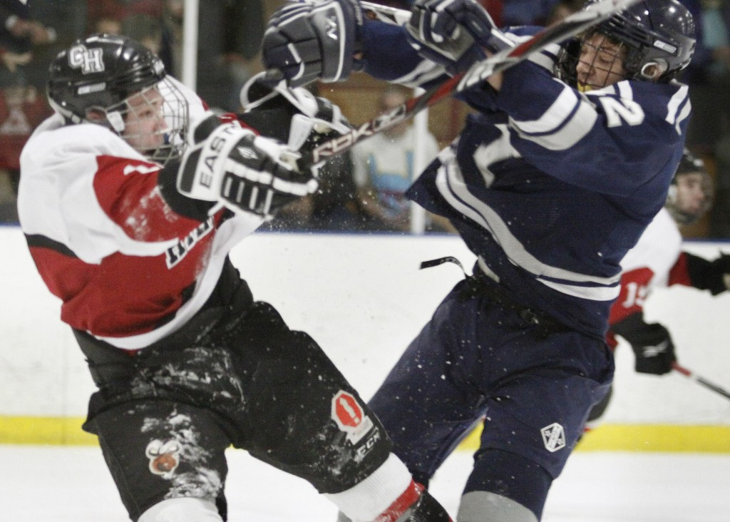 Marshall Brunelle, right, of Yarmouth collides with Wayne Neiman of Camden Hills during their Western Class B semifinal at Portland Ice Arena. Yarmouth advanced to the regional final with a 3-1 victory.