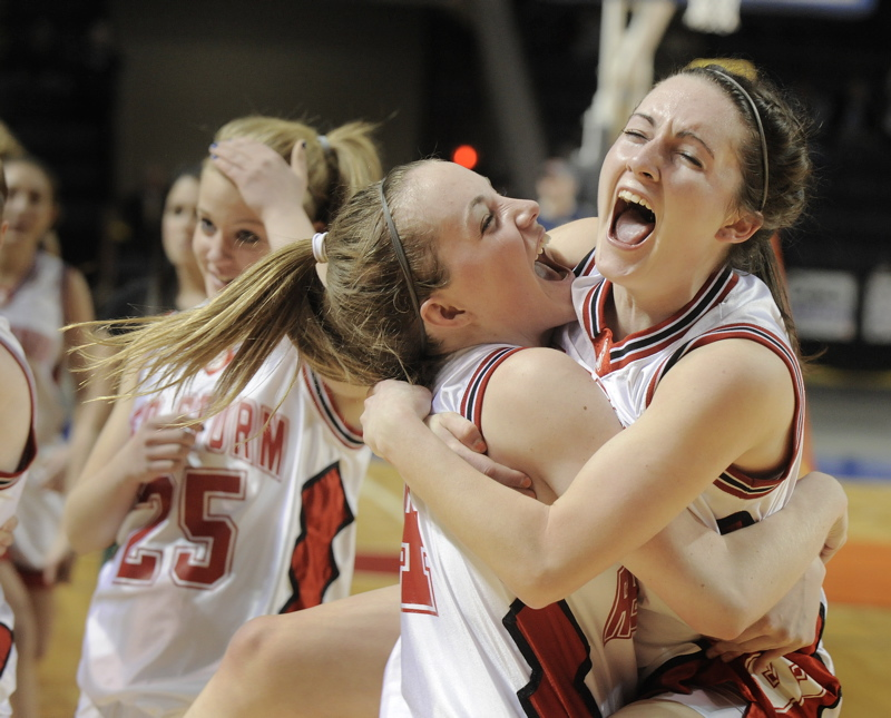 Heather Carrier, left, and Brittany Ross embrace after Scarborough, on a winning basket by Christy Manning with 11.8 seconds remaining, overcame Deering for a 37-34 victory in Western Class A championship game. Scarborough will meet Skowhegan in the state final.