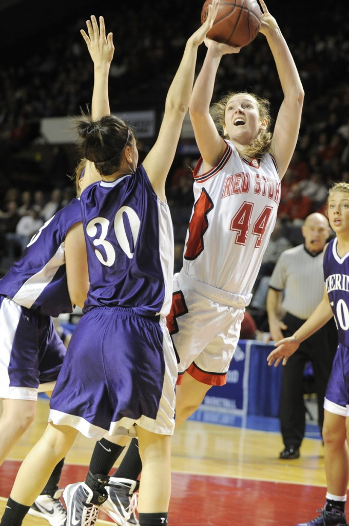 Scarborough's Christy Manning shoots over Aarika Viola.