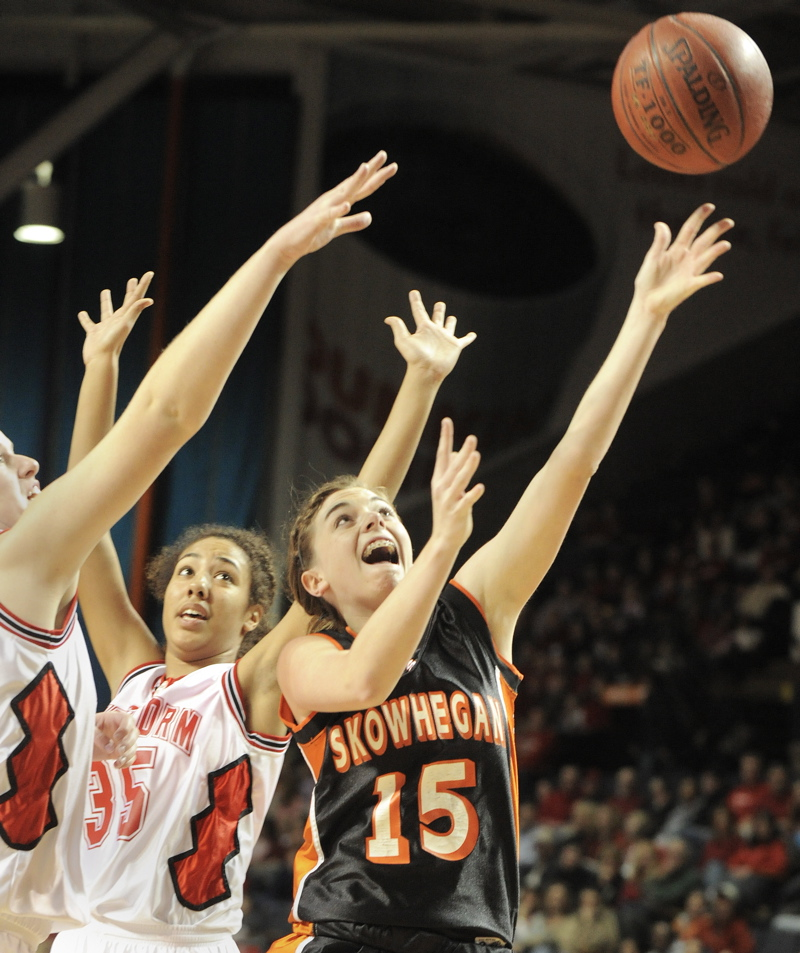 Adrienne Davis of Skowhegan slips through the Scarborough defense on her way to the basket.