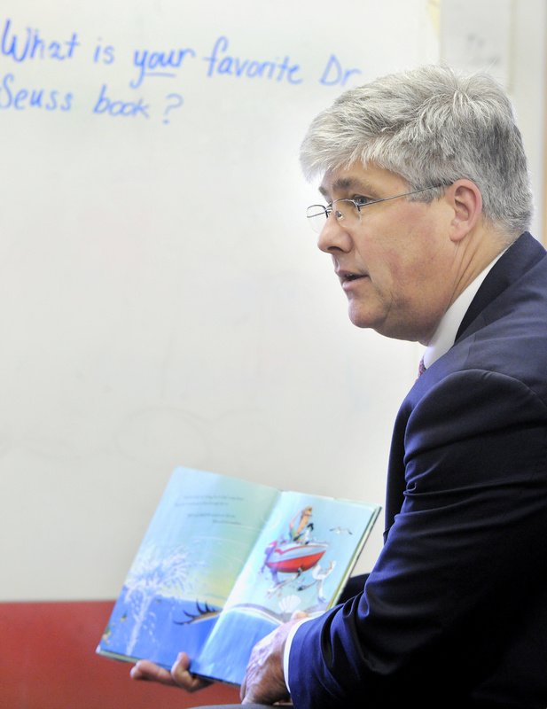 Portland Mayor Nicholas Mavodones reads to pupils at Hall School as part of Read Across America Day on Tuesday.