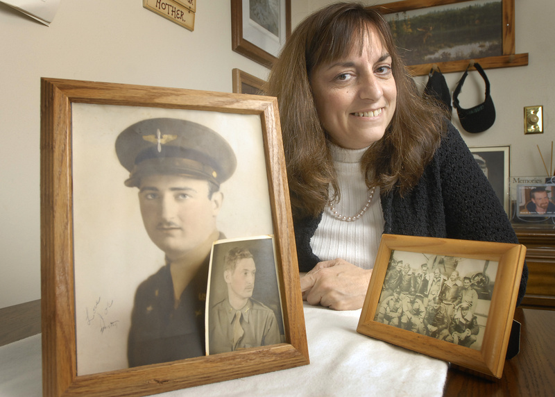 John Ewing/Staff Photographer Lisa Phillips of Windham shows photos of her uncle, 2nd Lt. Joseph C. Rich of Portland. A search group recently located the site in India where his remains are believed to be. Phillips heads a group that lobbies to repatriate the remains of World War II servicemen who vanished overseas.