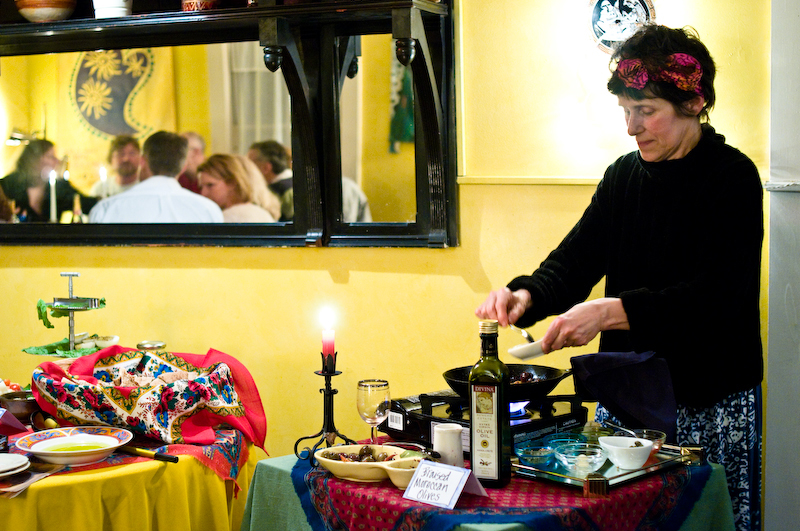 Cathi DiCocco, owner of Cafe DiCocoa in Bethel, prepares a braised Moroccan olive dish during Saturday's Gentle Dining meal, which featured vegetarian cuisine from Morocco and Egypt.