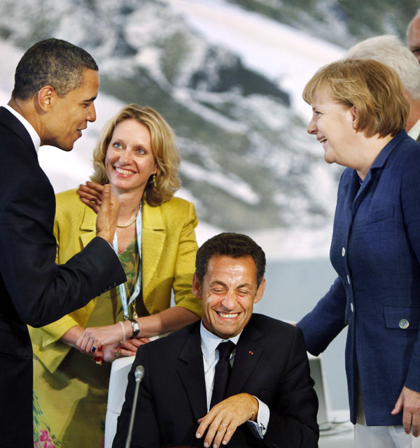 Obama jokes with French President Nicolas Sarkozy, seated, and German Chancellor Angela Merkel, right, before the start of G8 meetings in L'Aquila, Italy. How does Obama rate on the scale of modern presidential humor? Pretty high, it turns out.