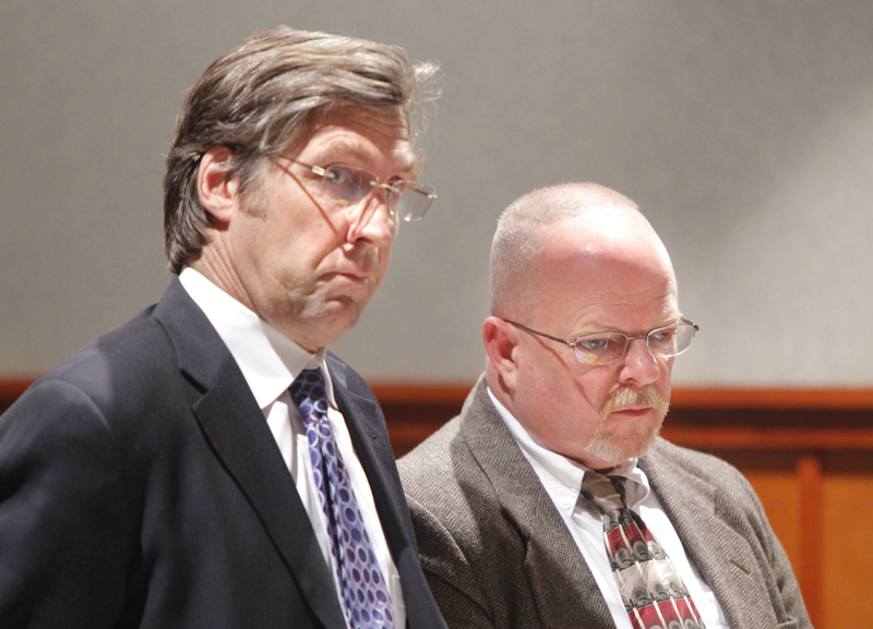 Malcolm Bruce Davidson, right, listens as Justice Robert Crowley imposes a sentence of 15 years in prison with all but 10 years suspended for the death of Fred Wilson in South Portland. At left is Davidson's attorney, Thomas Hallett.