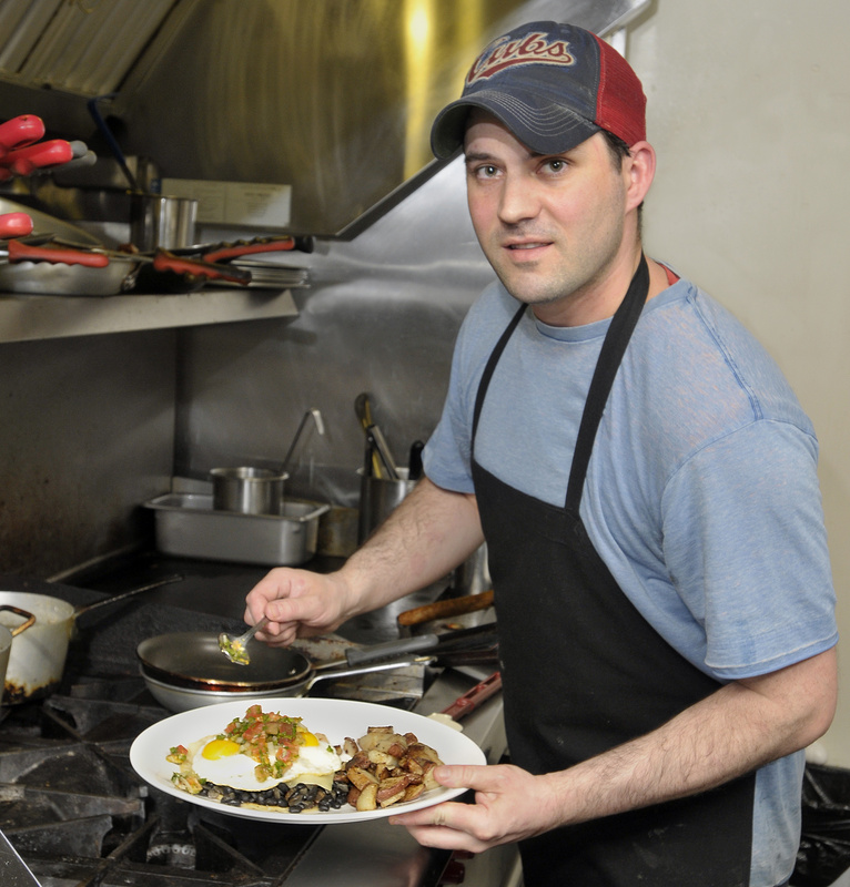 Keith Voight, owner/chef of Mousse Cafe and Bakeshop, makes a morning favorite, huevos rancheros.