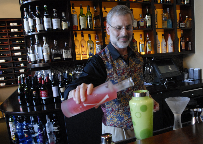 Steve Lovenguth, bar manager at Walter's, mixes a Union of Four, which combines Domaine de Canton ginger liqueur, Hypnotiq liqueur, St. Germain elderflower liqueur, X-Rated Fusion liqueur and passion fruit juice.