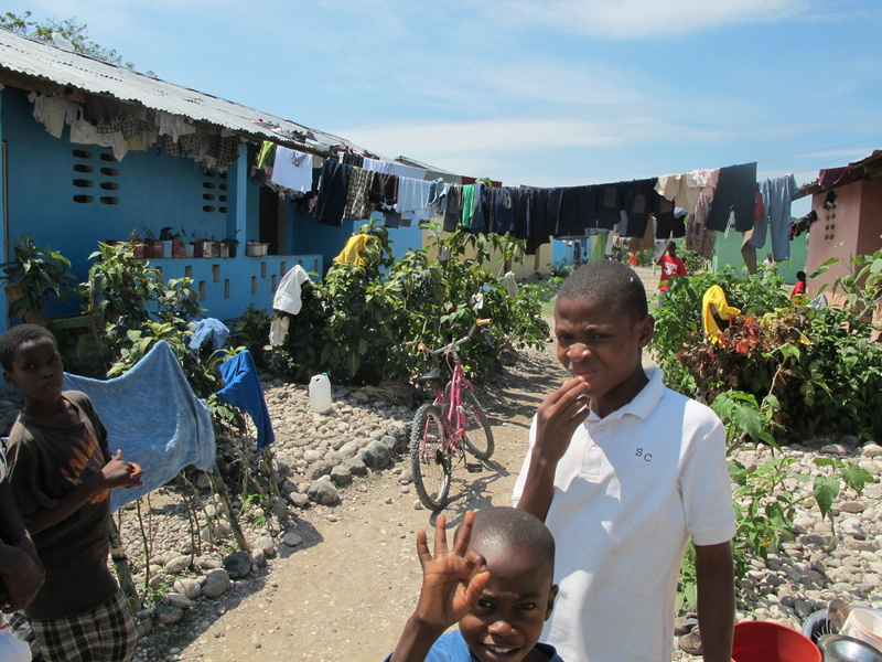 Orphan boys greet visitors to their housing units at Hope Village in Les Cayes, where they maintain small gardens at the entrance to each dormitory. The village has recently added about 200 children, fleeing the aftermath of the Jan. 12 quake.