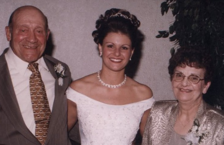 Domenic Mazziotti, with his wife Phyllis, at right, and their granddaughter Erica at her wedding.
