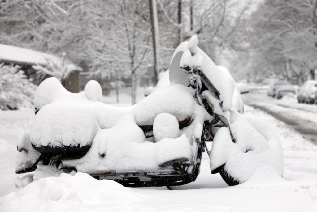 A motorcycle is muffled by snow in this file photo. Many Mainers would prefer to keep them quieter even when they are moving, say a number of readers.