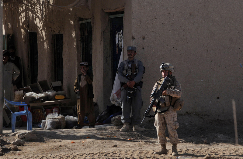A U.S. Marine stands guard Monday in Marjah, Helmand province. In the coming days and weeks, with Marines providing a backbone of security, Afghan officials will reopen schools, expand critical irrigation system and set up the government.