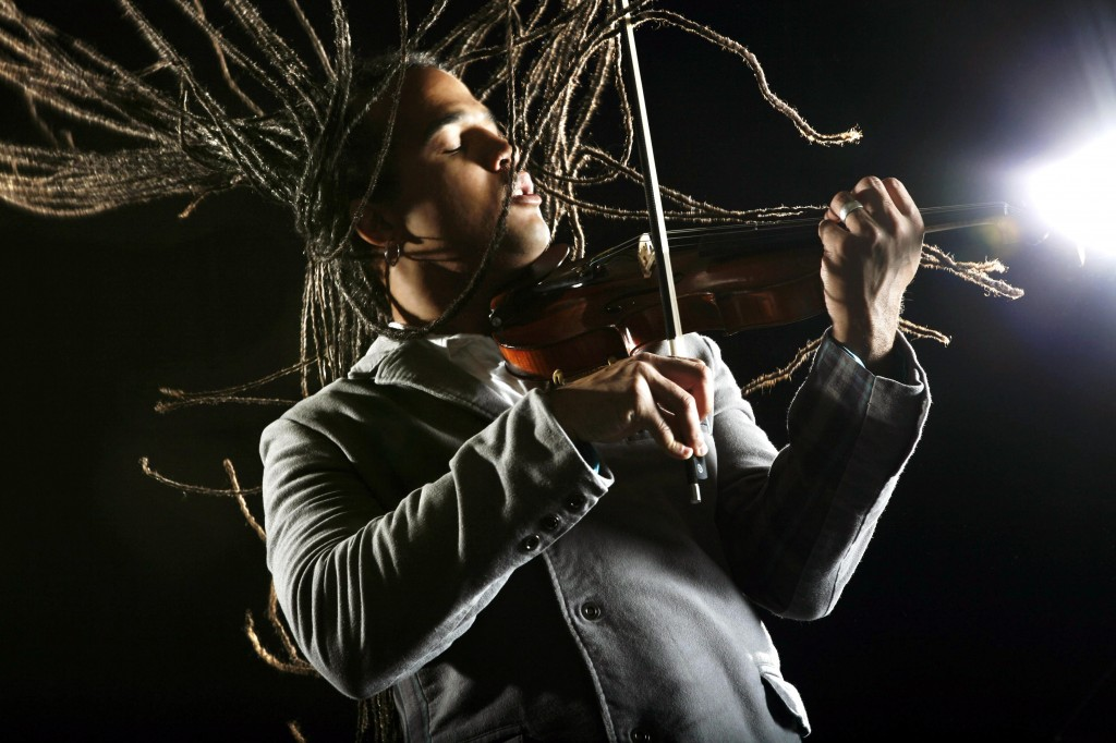Violinist Daniel Bernard Roumain performs with his quartet and student musicians from Maine on Sunday at the Rockport Opera House.