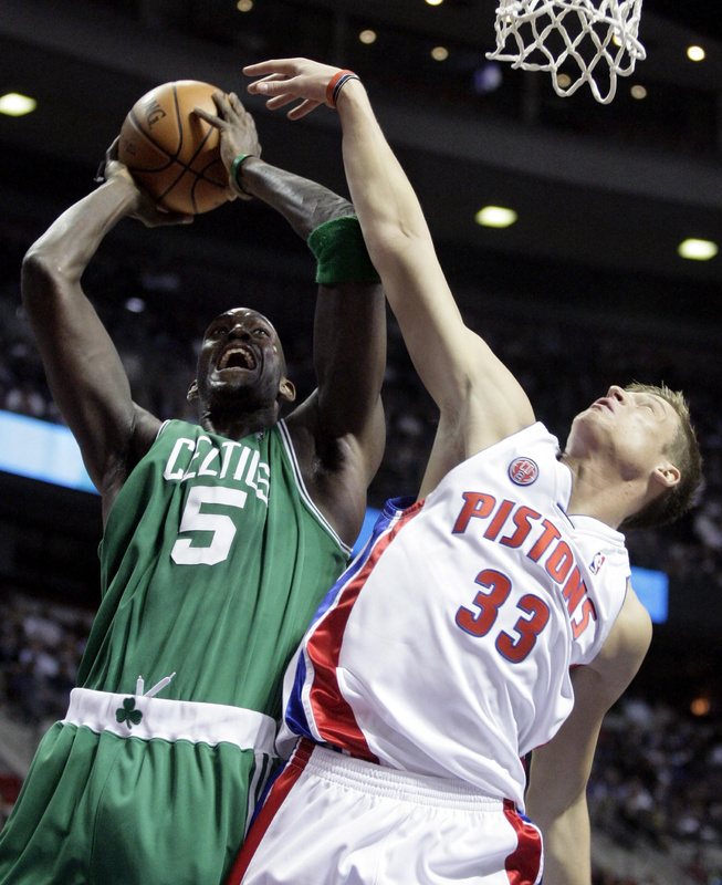 Kevin Garnett of the Boston Celtics takes the ball to the basket Tuesday night against Jonas Jerebko of the Detroit Pistons during the Celtics' 105-100 victory.