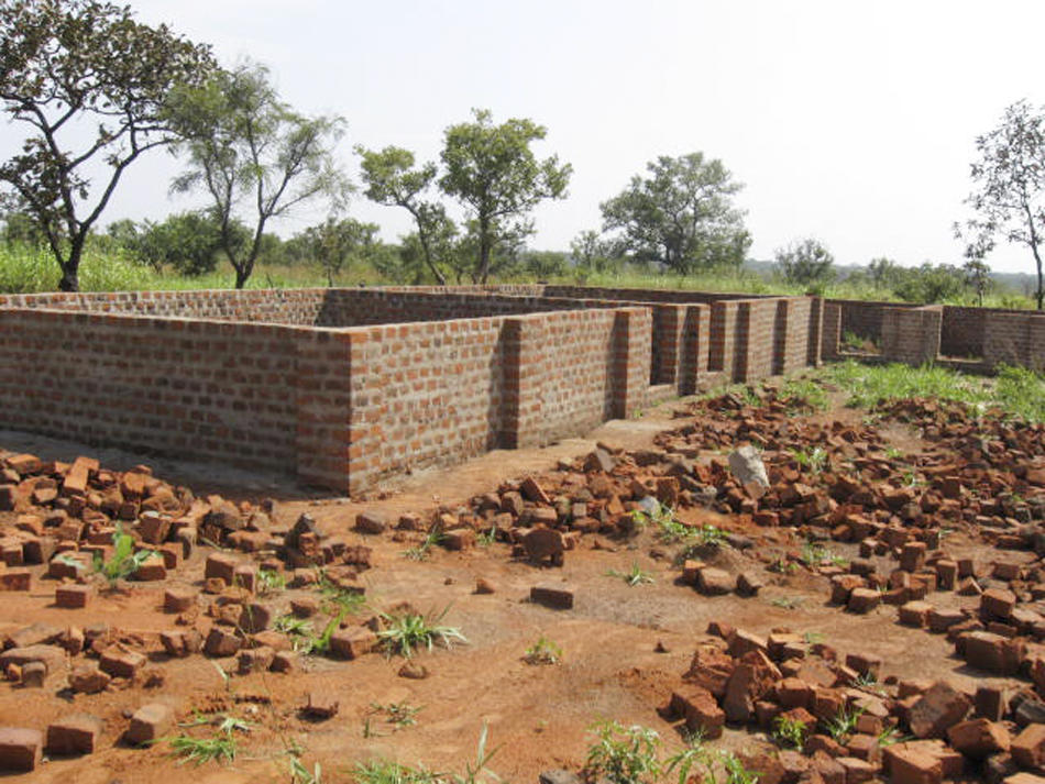 The foundation and walls of the ASERELA Maine Primary School in Kit, Sudan, were completed last summer. Portland's Sudanese community hopes to raise enough money to finish the school this summer. Many children in the poor region have no schools to attend.