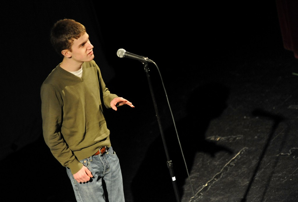 "Aaron Bartlett, a senior at Gorham High School, performs ""La Figlia che Piange"" by T.S. Eliot during the first of three rounds at the Poetry Out Loud state finals Friday evening at the Waterville Opera House. Champion Will Whitham, a Bangor High senior, will go to Washington D.C. for the national finals in April."