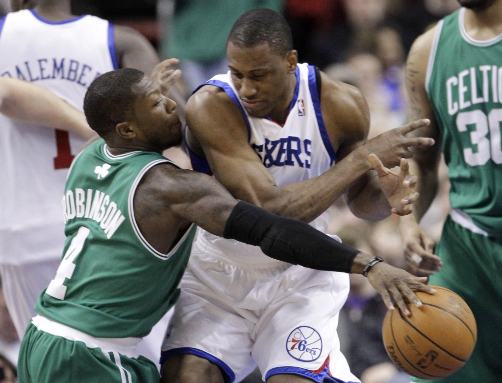 Nate Robinson of the Boston Celtics, left, steals the ball from Thaddeus Young of the Philadelphia 76ers during the first half of the Celtics' 96-86 victory Friday night.