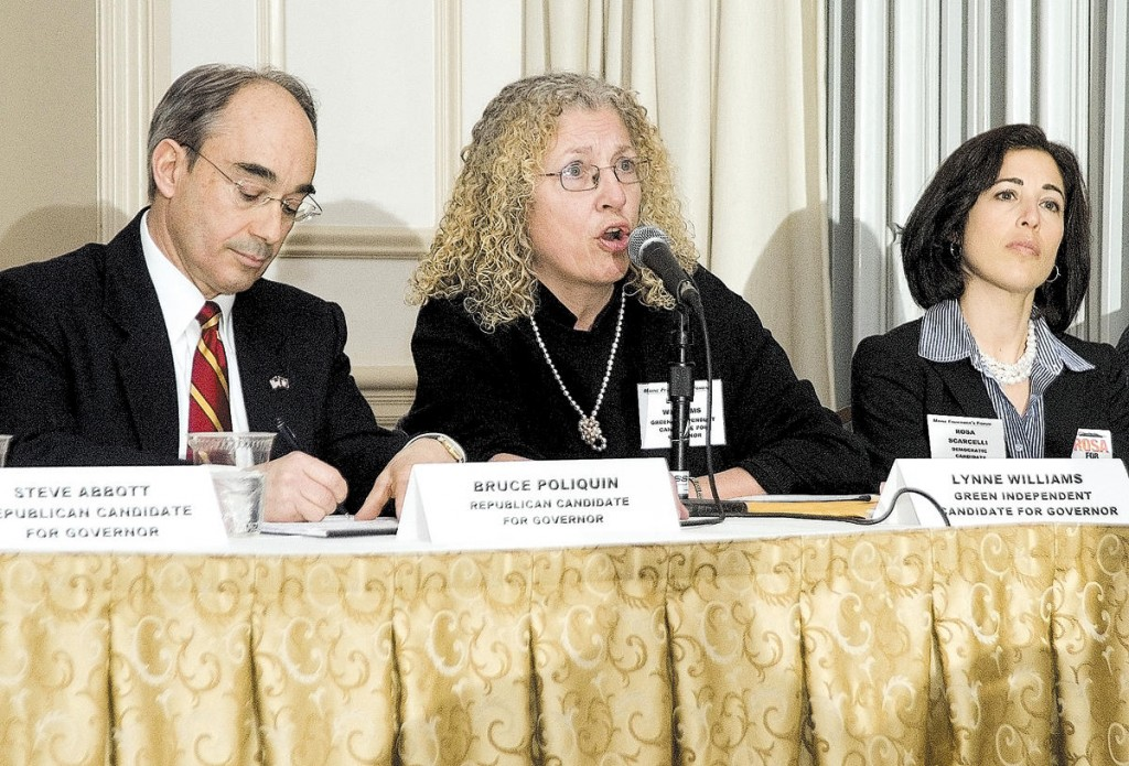 Green Independent Lynne Williams, center, speaks during Friday's gubernatorial candidate forum at the Samoset Resort in Rockport. She is flanked by Republican Bruce Poliquin, left, and Democrat Rosa Scarcelli.