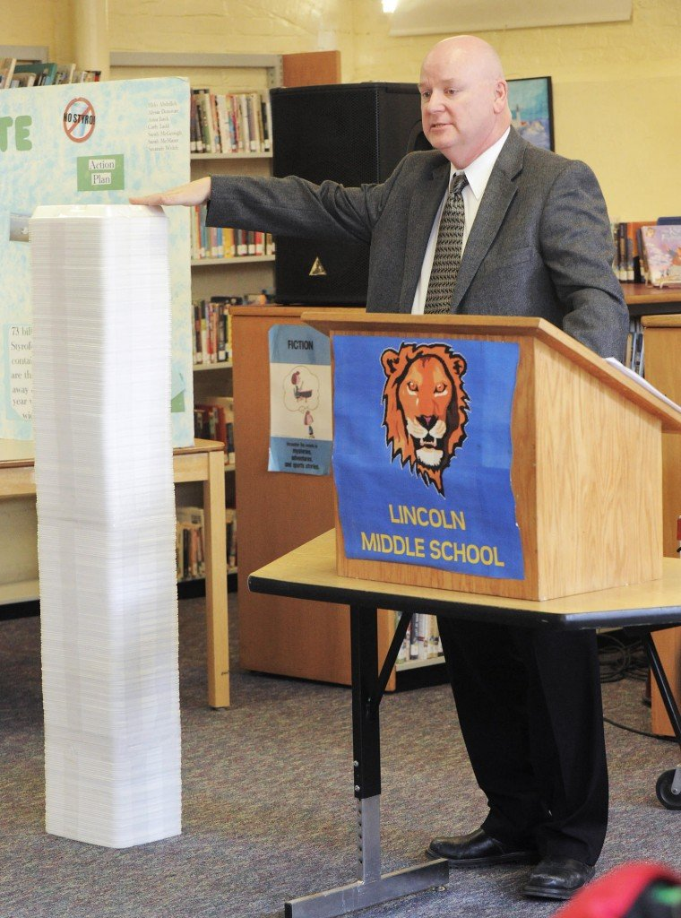 Portland Superintendent of Schools Jim Morse shows the amount of Styrofoam waste generated each day at Lincoln Middle School as part of the recycling program introduction.