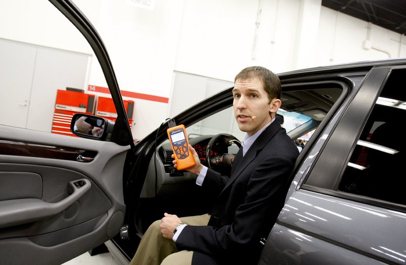 Dr. Matthew Schwall, an engineer with Exponent Inc., a consulting firm hired to do safety testing by Toyota, performs a pedal test on a BMW during a live webcast Monday at Toyota headquarters in Torrance, Calif.