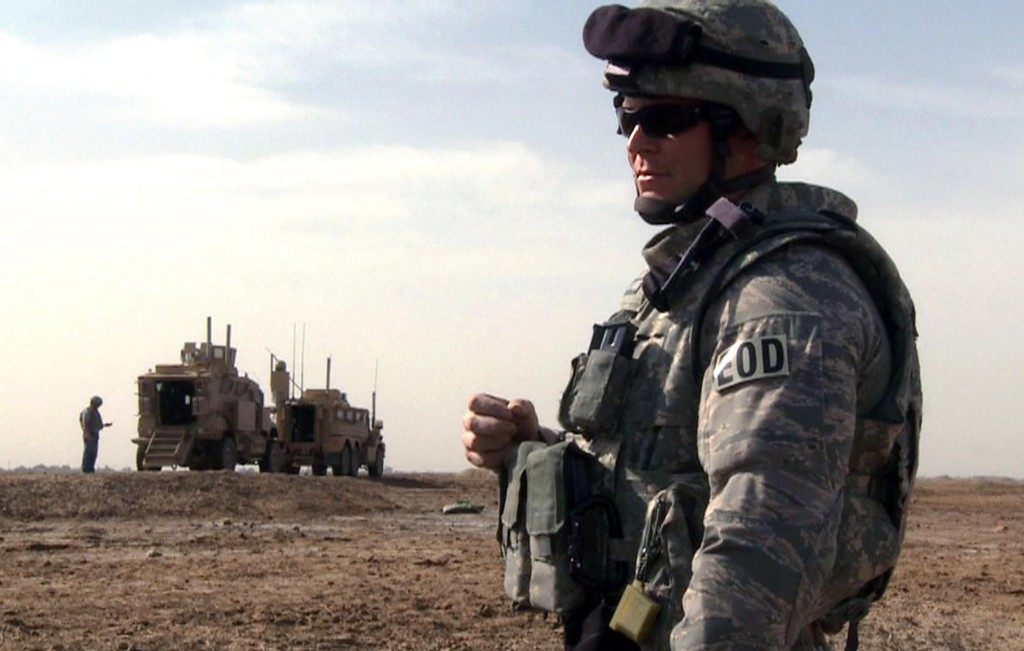 FACT: Tech Sgt. Jeremy Phillips waits for his team members to prepare a detonation outside of Forward Operating Base Garry Owen on Monday in Maysan province, Iraq. In real life, bomb technicians break out their bulky bomb suits only as a last resort, preferring the safer means of disarming bombs remotely.