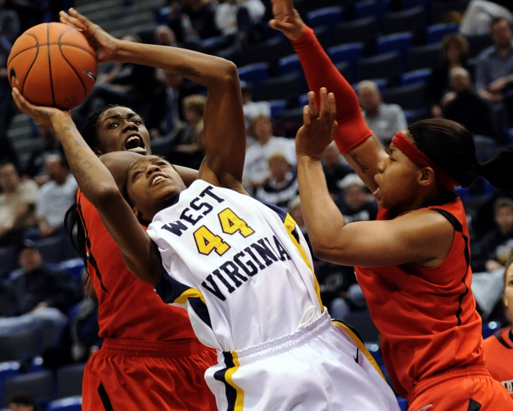 Madina Ali of West Virginia tries to put up a shot while facing double-team pressure from Rutgers during the Big East semifinals Monday night at Hartford, Conn. No. 9 West Virginia advanced with a 56-49 victory.