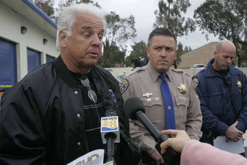 James Sikes, left, of Jacumba, Calif., describes to the media how he was able to bring his runaway Prius to a stop on the highway Monday, with the help of Officer Todd Niebert, right, of the California Highway Patrol. At center is Officer Brian Pennin, a CHP spokesman.