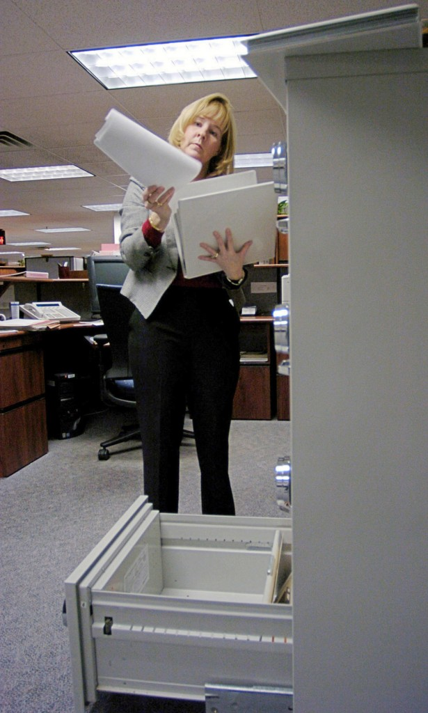 Susan Chapman, director of the Division of Federal Investments, looks at paper securities at the Treasury Department's Bureau of Public Debt offices in Parkersburg, W.Va. The retirement nest egg of an entire generation is stashed away in this small town: $2.5 trillion in IOUs from the federal government, payable to the Social Security Administration.