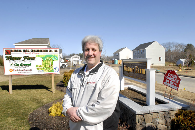 Bill Risbara stands in front of a Risbara Bros. construction site in Gorham where he is developing a 42-lot subdivision. Risbara said he''s down to 16 lots at Wagner Farm and is preparing to buy more land. ""