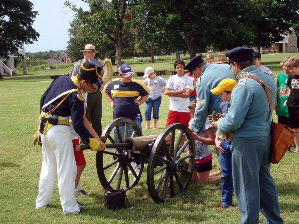 Visitors to Fort Scott National Historic Site watch a cannon demonstration.