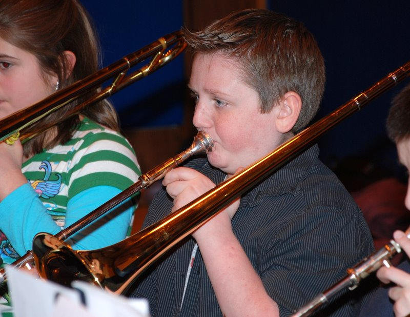 Saco Middle School band student Jeffrey Foran plays trombone during an honors band and chorus concert performed by area Grade 6 musicians and singers at Old Orchard Beach.