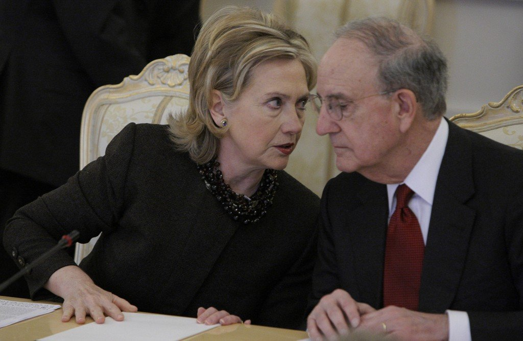 U.S. Secretary of State Hillary Rodham Clinton speaks with U.S. special envoy for Mideast peace George Mitchell during talks in Moscow on Friday with the Quartet of Middle East peace mediators. Mitchell will be in Israel Sunday to meet with the prime minister.